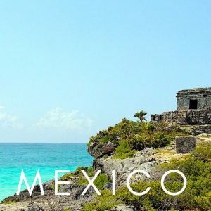 Tulum ruins over Caribbean Sea in Mexico
