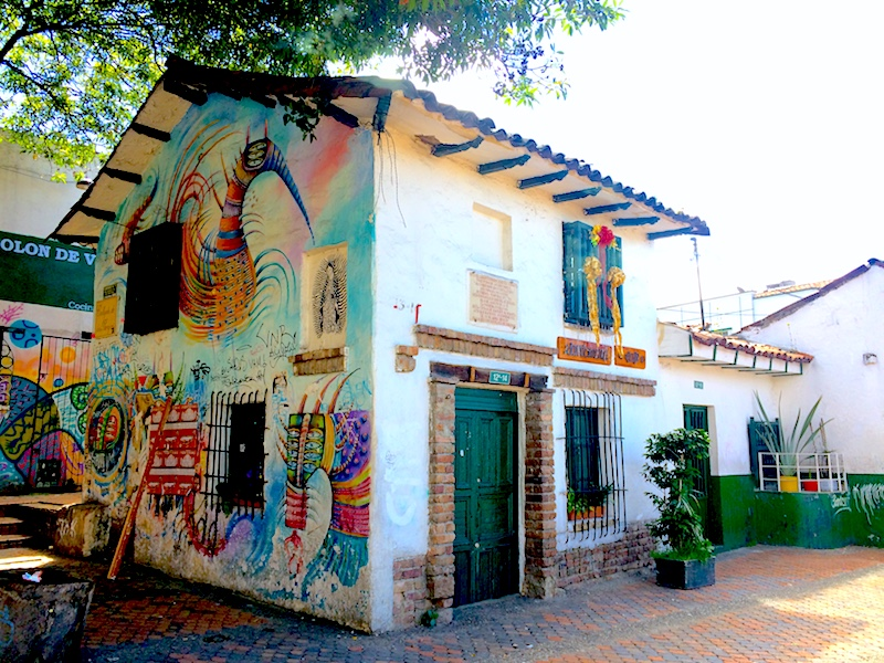 An old building covered in street art in Bogota, Colombia.