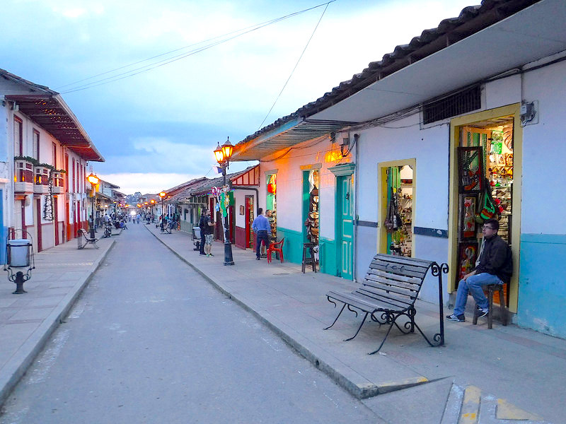Looking down a street in quaint town of Salento at dusk.