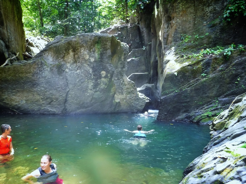 Swimming to a waterfall in Three Pools, Trinidad