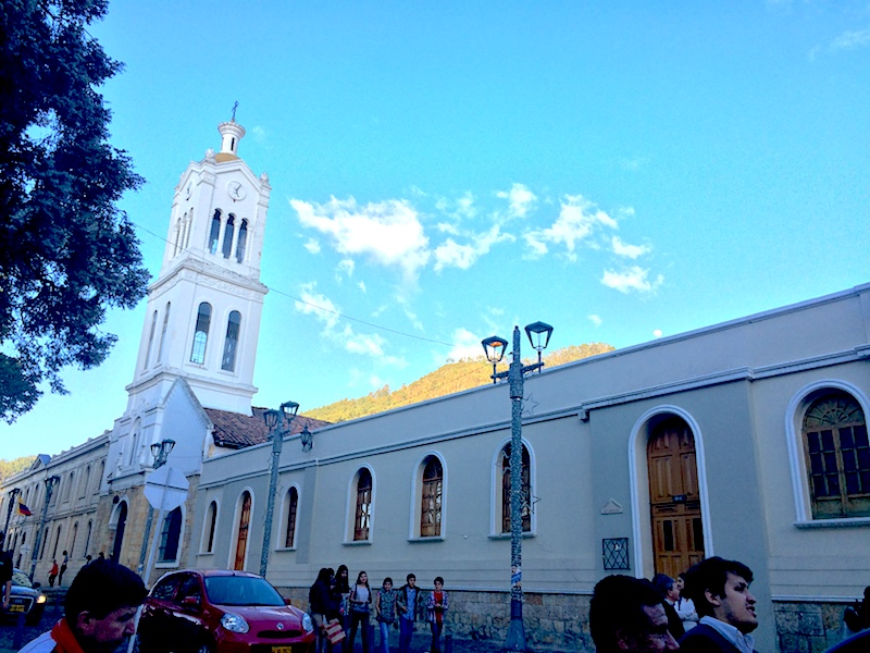 White church building with blue sky in Usaquen, Colombia.
