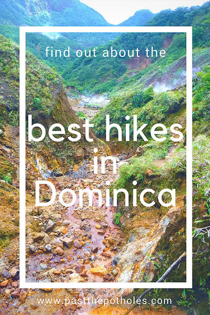 Looking through a volcanic valley with text: Find out about the best hikes in Dominica.