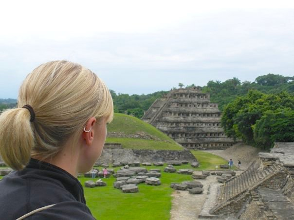 Woman looking at detailed pyramid and ruins at El Tajin, Mexico