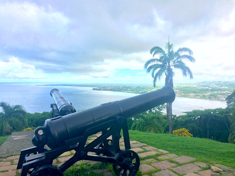 Looking over two canons to the Tobago coast and Caribbean Sea at Fort King George.