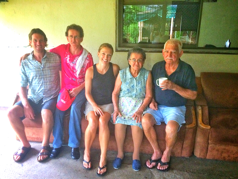 Five people sitting on a couch together in Jicaral, Costa Rica.