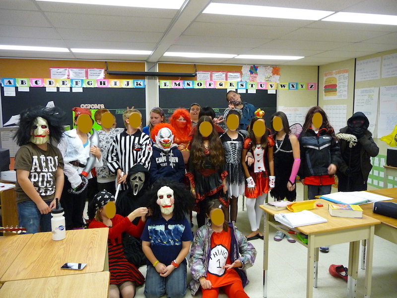 Group of students dressed up for Halloween in a classroom.
