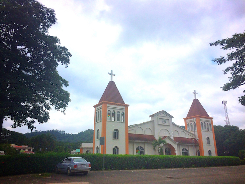 Yellow and cream coloured large church in Jicaral, Costa Rica.