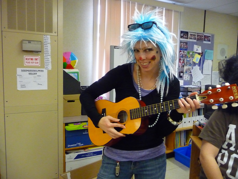 Teacher dressed up as funny rock and roll star.