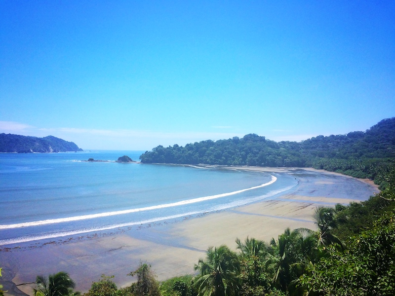Beautiful blue water and sky in long horseshoe bay at Curu National Park, Costa Rica
