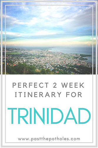 Sunset over Port of Spain and water with text: Perfect 2 week itinerary for Trinidad.