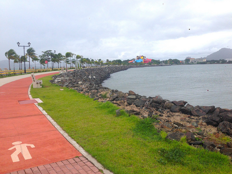 Biking path and water's edge along Amador Causeway in Panama City, Panama.