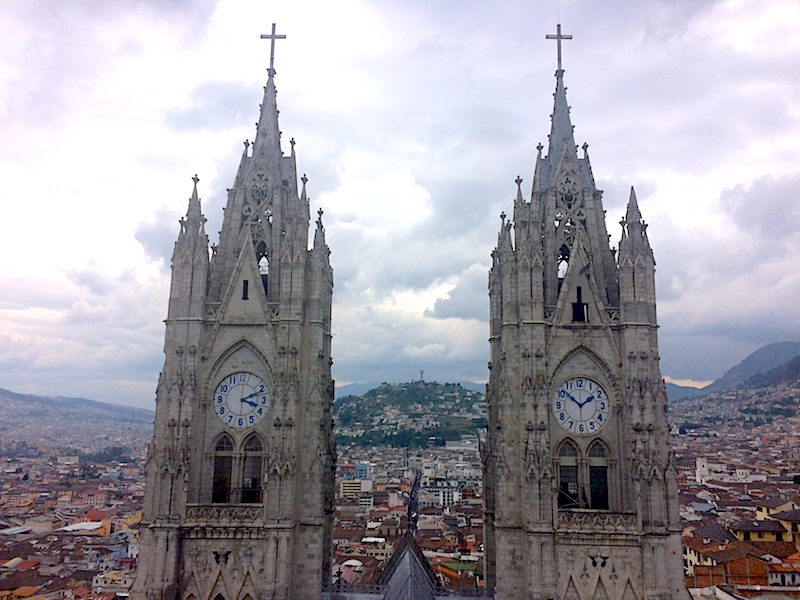 Twin towers of basilica church overlooking Quito Ecuador