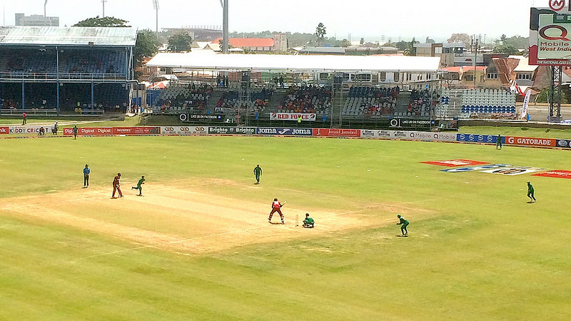 A cricket match is being played inside a stadium - sports activities in Trinidad