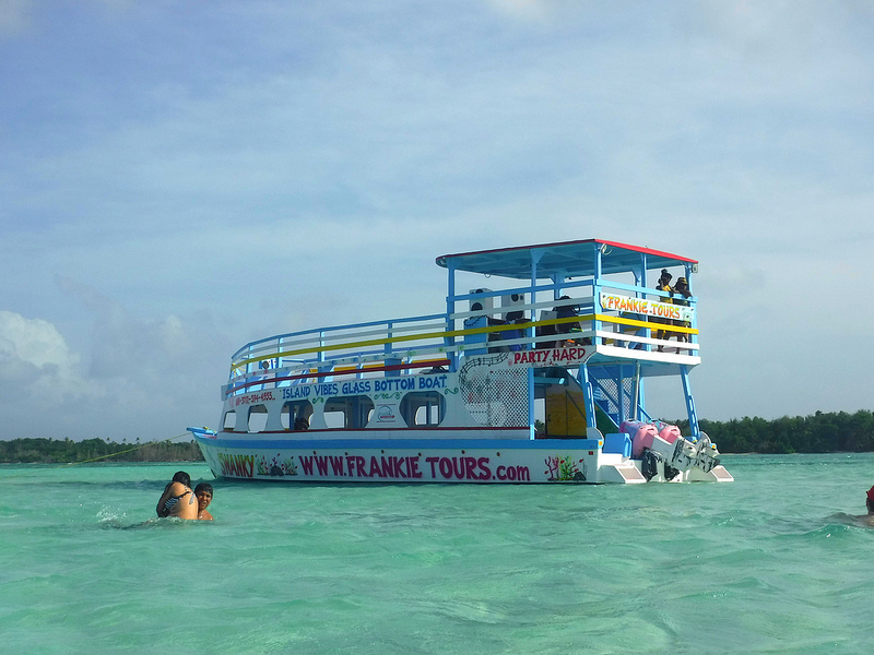 Glass bottom boat at turquoise waters of Nylon Pool in Tobago