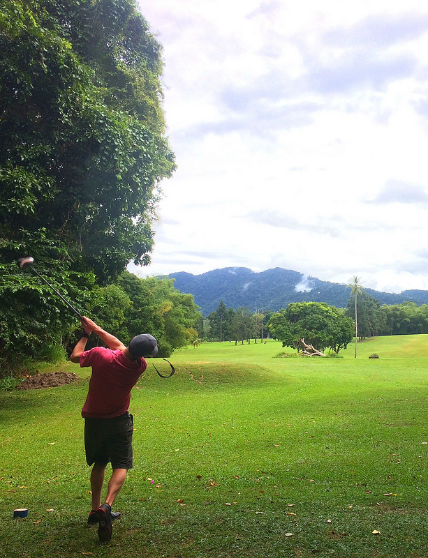 Man swinging on the tee at Chaguaramas Golf Course, Trinidad