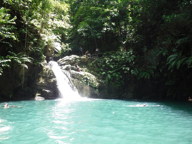 Rio Seco waterfall flowing into a blue pool - best things to do in Trinidad