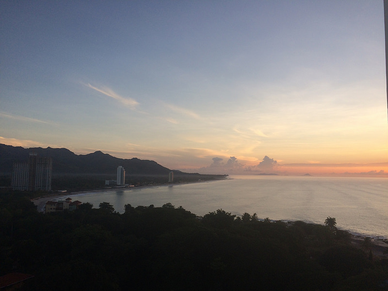 Beautiful sunrise over mountains and Pacific Ocean from a condo in Nueva Gorgona, Panama.