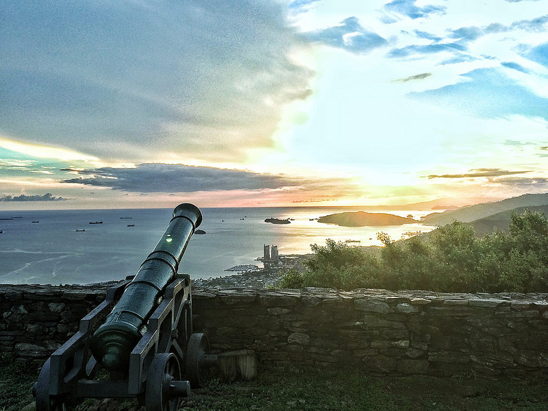 Sunset overlooking a canon and the water from Fort George, Port of Spain, Trinidad