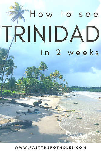 Deserted Caribbean beach with palm trees in Trinidad with text: How to see Trinidad in 2 weeks.