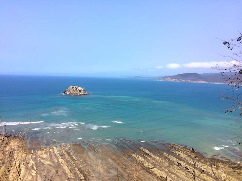 Looking across jagged rocks to the turquoise Pacific Ocean from the mirador at Playa los Frailes, Ecuador.
