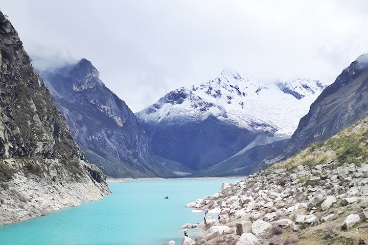 Bright turquoise glacier lake, Laguna Paron, backed by snow-capped Andes mountains in Huaraz, Peru.