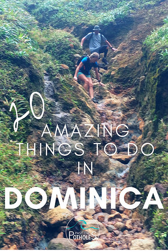 Couple climbing down a rocky cliff to Boiling Lake, Dominica.