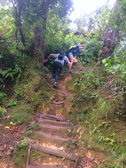 Couple climbing up steep steps on hike to Boiling Lake, Dominica.