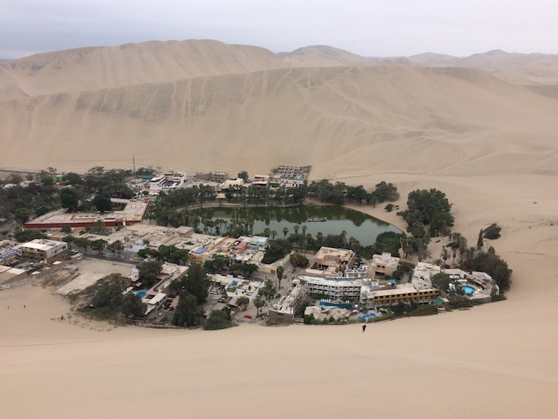 Desert oasis, Huacachina, from the sand dunes above in Peru.