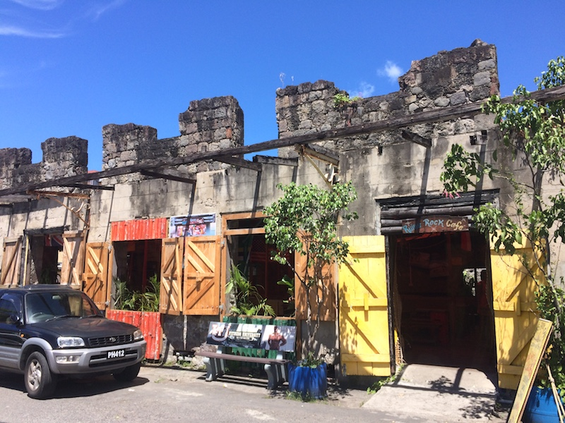 Colourful, derelict building filled with cafes in Roseau, Dominica.