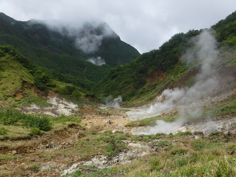 Pockets of steam throughout a dry rugged valley in Dominica.