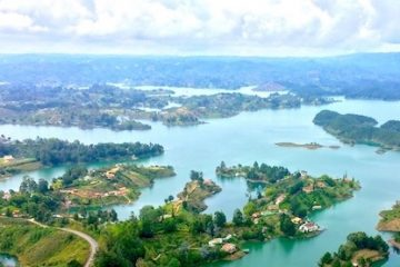 view over the blue lakes and green islands of Guatape, Colombia