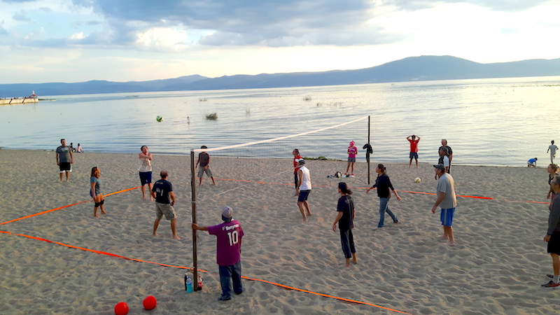 Group playing volleyball at dusk on the beach at Lake Chapala, Mexico.