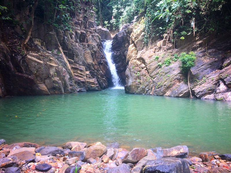 The Paria waterfall with a pool to swim in front surrounded by rocks.