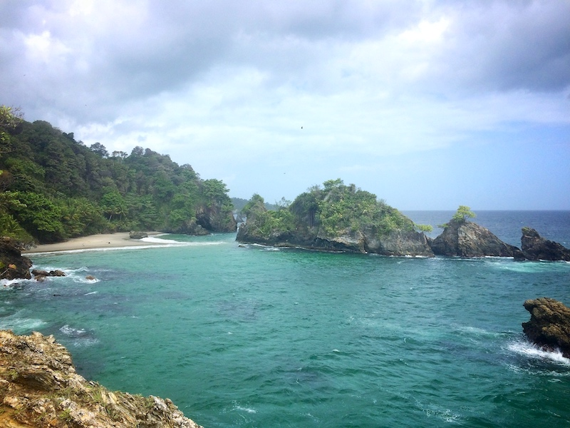 A small sandy cove surrounded by rocks at Paria Bay, Trinidad