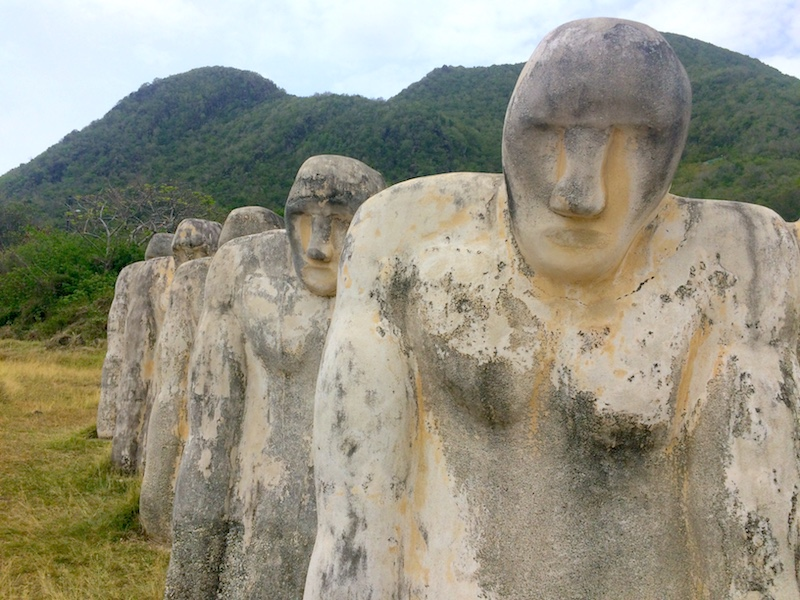 Close up of stone people at Anse Cafard Slave Memorial, Martinique