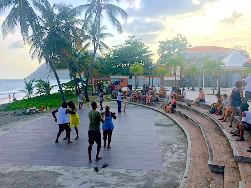 Couples dancing in a plaza in Le Diamant, Martinique.