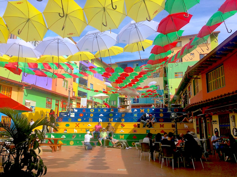 Plaza covered with brightly coloured umbrellas in Guatape, Colombia.