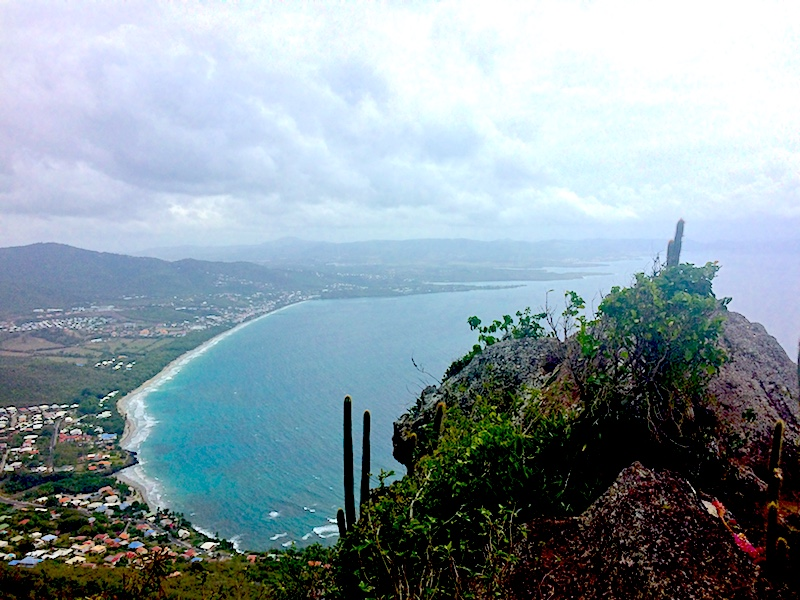 Sweeping view of bay of Le Diamant, Martinique from summit of Morne Archer volcano.