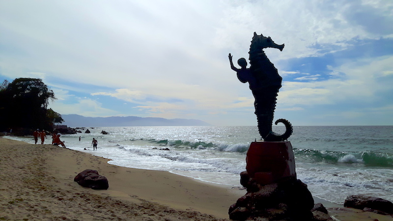 Statue of a boy on a seahorse on a beach in Puerto Vallarta, Mexico.