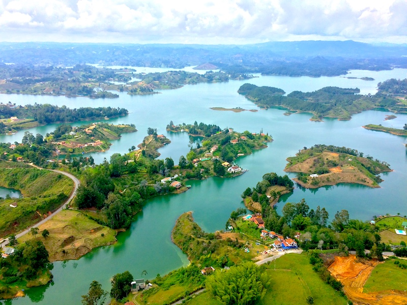 Blue lakes and green islands fill the landscape view from top of el Penon, Guatape, Colombia.