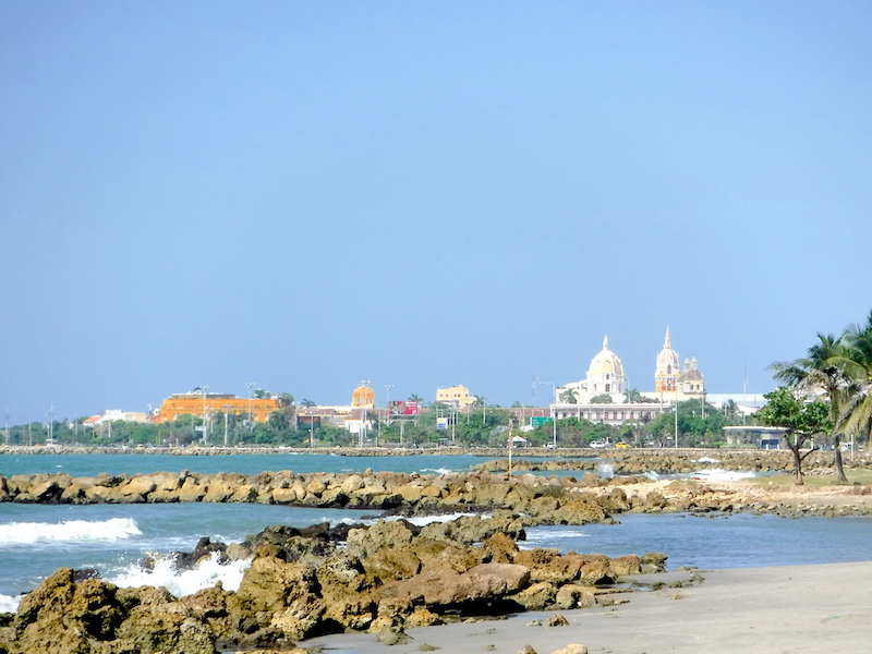 Skyline of the old city of Cartagena, Colombia from the rocky beach.