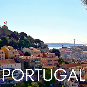 red tiled rooftops of Lisbon, Portugal with castle and bridge in the background. Text: Portugal
