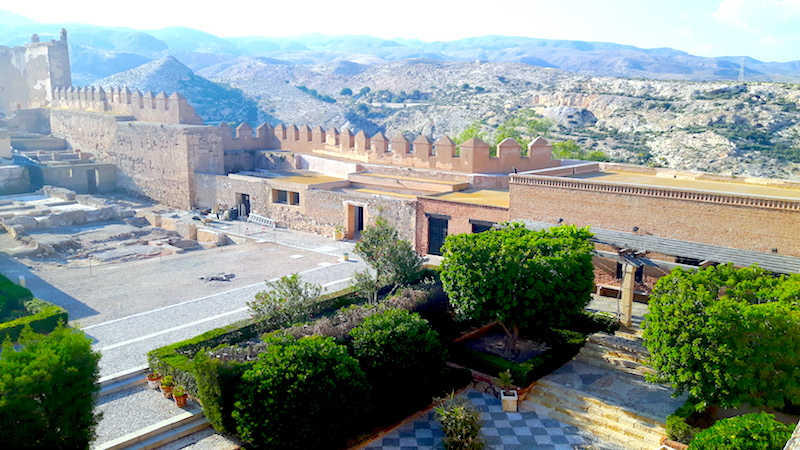 Looking down on the ancient alcazaba with mountains beyond in Almeria, Spain.