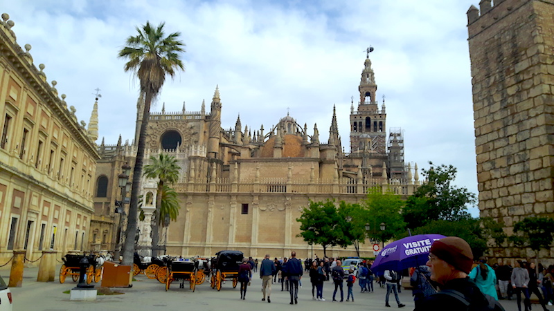 Plaza surrounded by grand buildings in Seville, Spain.