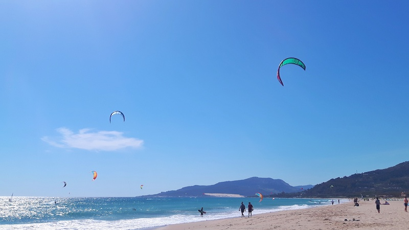 People kitesurfing in Tarifa, Spain.