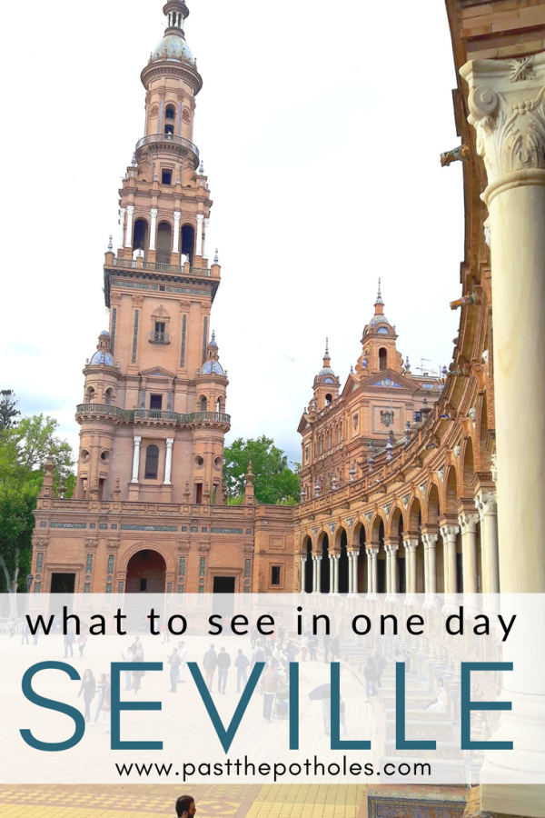 Tower of building in Plaza Espana with the text: what to see in one day, Seville.