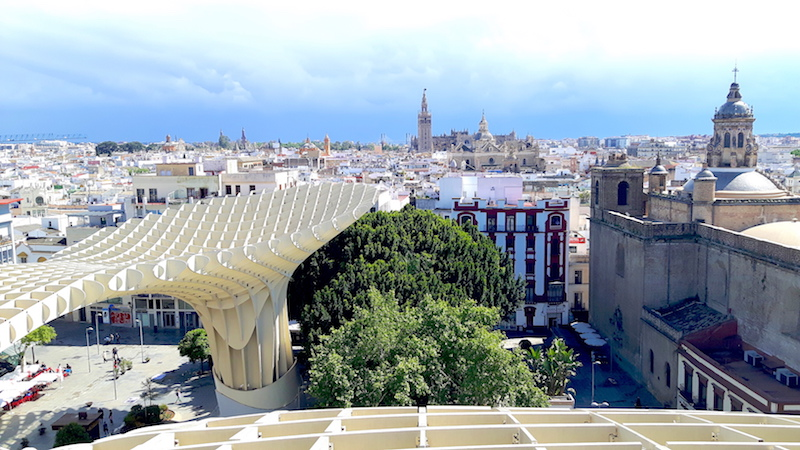 View of historic buildings from the top of setas de Sevilla, Spain.