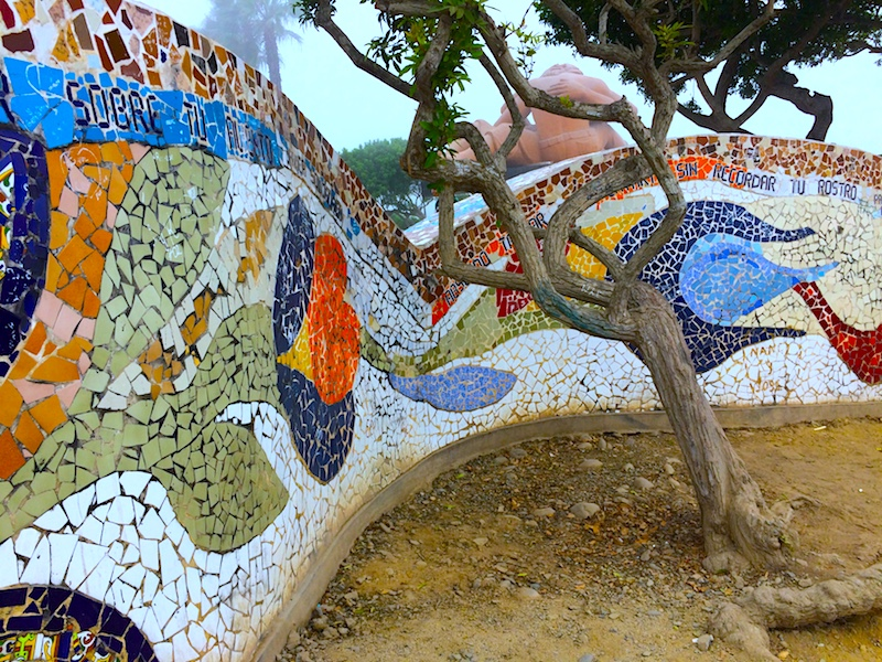 colourful mosaic wall with a twisted tree inside in Parque del Amor, Lima Peru.