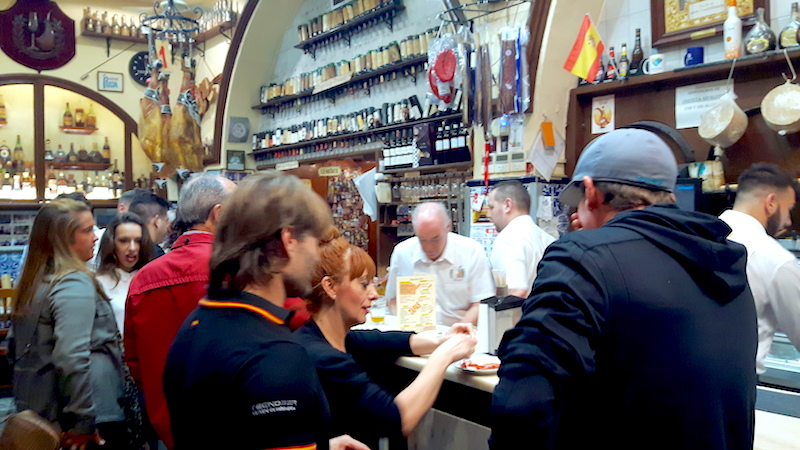 People eating in popular traditional tapas bar in Almeria, Spain.