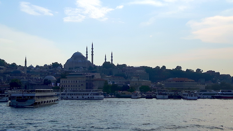 Minurets and mosques in the skyline of Istanbul, Turkey from a Bosphorus cruise.